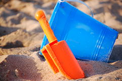 Sand toys. Beach toys, bucket and shovel in the sand Stock Image