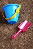Sand toys. Kids' sand colored toys shovel and bucket Royalty Free Stock Photography