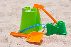 Sand toys on the beach Stock Photos