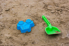 Sand toys in the playground Stock Images