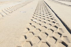 Sand track. Abstract composition for tracks on sand from tire Stock Photos