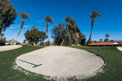 Sand trap or bunker near a golf green Stock Photo