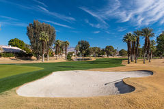 Sand trap or bunker near a golf green Stock Image