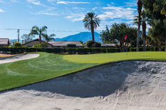 Sand trap or bunker near a golf green Stock Images