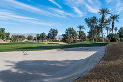 Sand trap or bunker near a golf green Royalty Free Stock Images