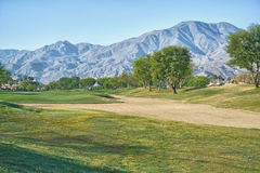 Sand Trap and Fairway at PGA West La Quinta California. This is looking towards the mountains which surround the course Royalty Free Stock Photo