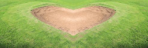 Sand trap golf course. Heart Sand trap golf course Royalty Free Stock Photos