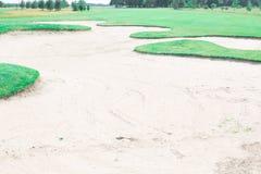 Sand trap at golf course Stock Photos