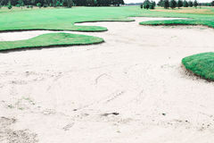 Sand trap at golf course Stock Image