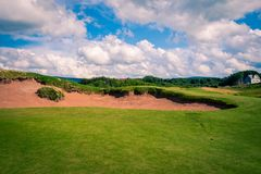 Sand trap on a golf course Stock Photo