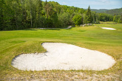 Sand trap in a golf course sand bunkers heart shape Royalty Free Stock Photo