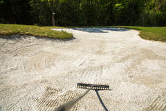 Sand trap, rake in a golf course sand bunkers, raking the sand Royalty Free Stock Images