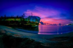 Sand-trapped Ship at Arabian ocean in Kerala seashore. The ship Hansita is now on a long wait for salvation from the sand floor to the deep waters Stock Photography