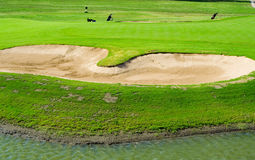 Sand traps. Sand bunkers and water on a golf course Royalty Free Stock Images