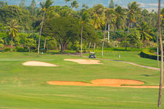 Sand Traps and a Golf Cart Near the Green Royalty Free Stock Photo
