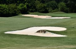 Sand traps on golf course Royalty Free Stock Image
