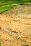 Sand traps ready to be groomed with rakes Royalty Free Stock Photo