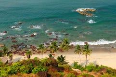 Beauty Arambol beach in India, Goa. Sand tropical beach with coconut trees and traditional boat - Arambol beach, Goa, India Royalty Free Stock Photo