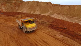 Sand truck moving at sand mine. Mining industry. Sand quarry. Sand truck moving at sand mine. Aerial view of mining truck transporting sand at quarry. Dump truck stock footage