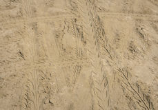 Sand tyre tracks background Royalty Free Stock Photo