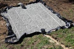 Sand-und Kies-Filterbett für septisches Becken Stockfotos