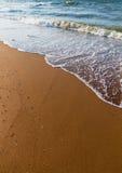 Sand und Welle lizenzfreies stockfoto