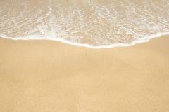 Sand und Welle Lizenzfreie Stockbilder