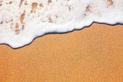 Sand und Wellenhintergrund stockbild