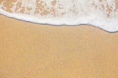 Sand und Wellenhintergrund stockfotografie