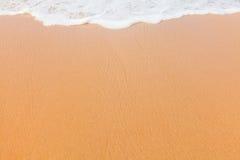 Sand und Wellenhintergrund lizenzfreies stockbild
