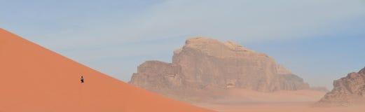 A long climb up the giant red sand dunes,  Wadi Rum, Jordan Stock Images