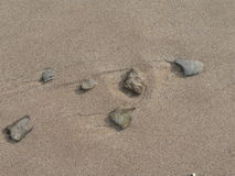 Sand washed pebbles Royalty Free Stock Image