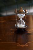 Sand watch. The old send watch on the table Royalty Free Stock Image