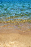 Sand and water. In the sunshine. Background Royalty Free Stock Image