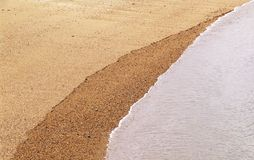 Sand and water. Background Stock Photography