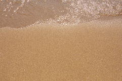 Sand and water on beach. Royalty Free Stock Image