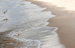 Sand and water. Beach sand and sea water waves Stock Image