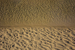 Sand and Water Patterns. Stock Images