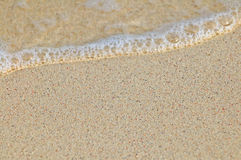 Sand and wave Royalty Free Stock Images