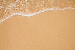 Sand and wave background Stock Photography