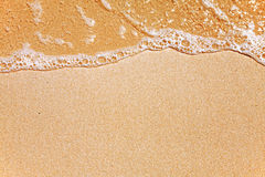 Sand and wave background Stock Photos