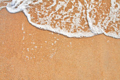 Sand and wave background Royalty Free Stock Photography
