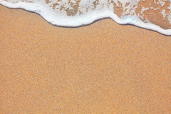 Sand and wave background Royalty Free Stock Photo