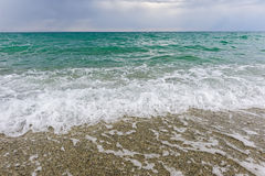 Sand and wave background Stock Images