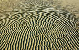 Sand wave background on the beach. Sand wave without water on the beach, background stock photo