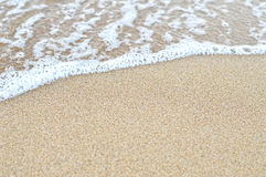 Sand and wave background Stock Image