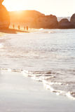 Sand and wave background at sunrise Royalty Free Stock Photos