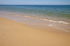 Sand and waves Royalty Free Stock Images