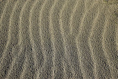Sand waves. Small wave ripples in the dry sand . Background Stock Photo