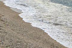 Sand and waves in the beach. In nature royalty free stock photos